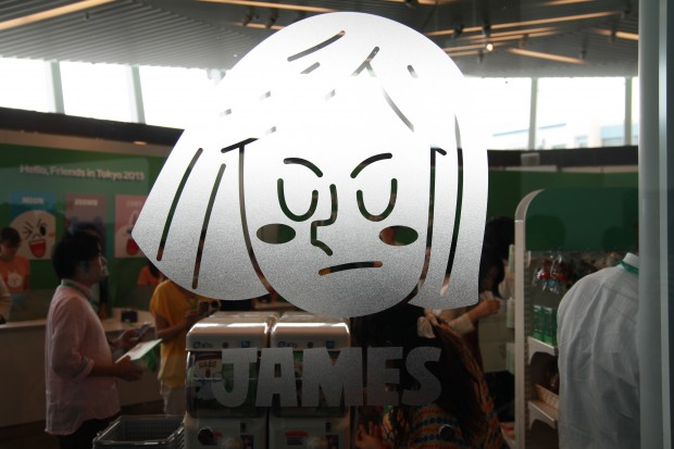 Line character James etched in frosted glass on the store window