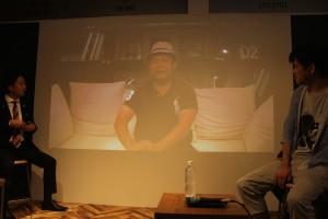 ビデオメッセージの孫泰蔵氏。「二年前にスタートアップ都市として日本の先駆けとなるものの構想したものが現実のものになっている。福岡がイノベーションの、日本の中心となるように、志をもった人たちがコミュニティをつくってほしい」と語った。