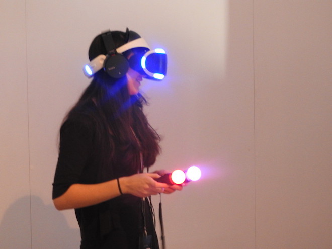 Above: A Latin American journalist tries out Until Dawn: Rush of Blood in virtual reality on the PlayStation VR at PSX. Image Credit: Dean Takahashi/GamesBeat