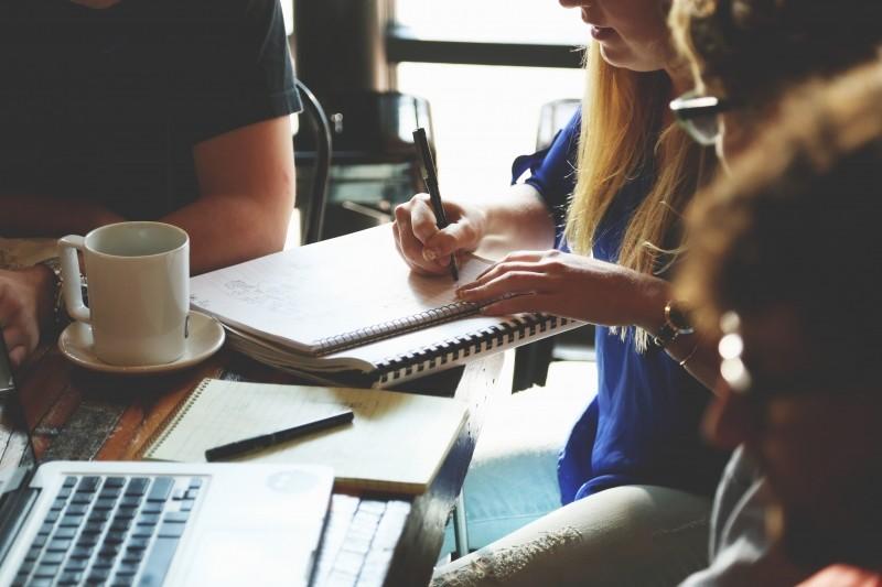 colleagues-having-business-meeting-in-coffee-bar.jpg