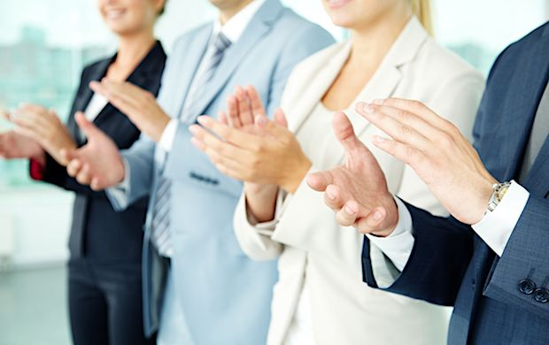 11989576 - photo of business partners hands applauding at meeting
