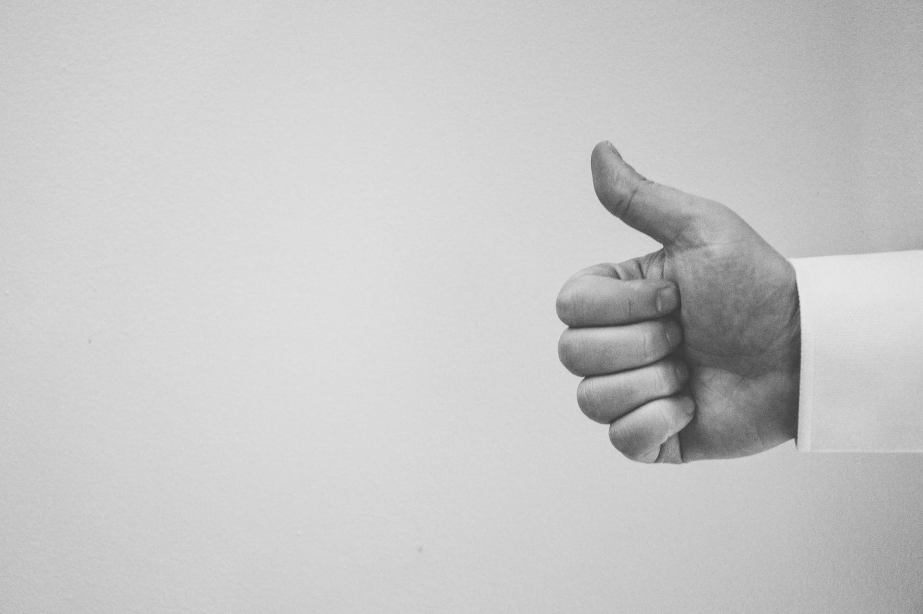 hand thumbs up thumb black and white