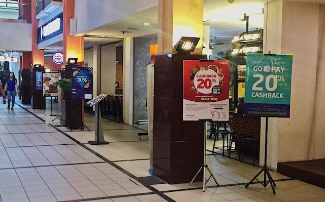 banners-showing-payment-app's-cashback-promos-at-a-jakarta-mall.jpeg