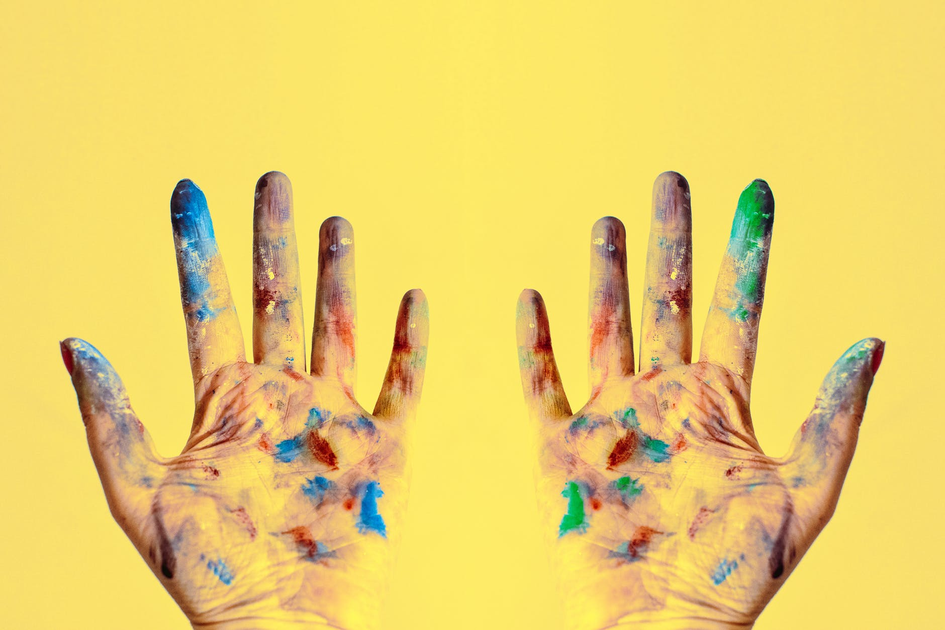 both hands stained with paints