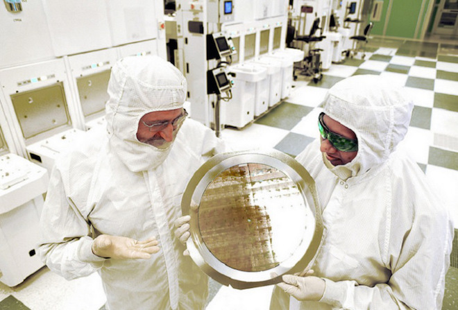 Above: IBM technicians hold wafer with 7-nanometer chips. Image Credit: IBM
