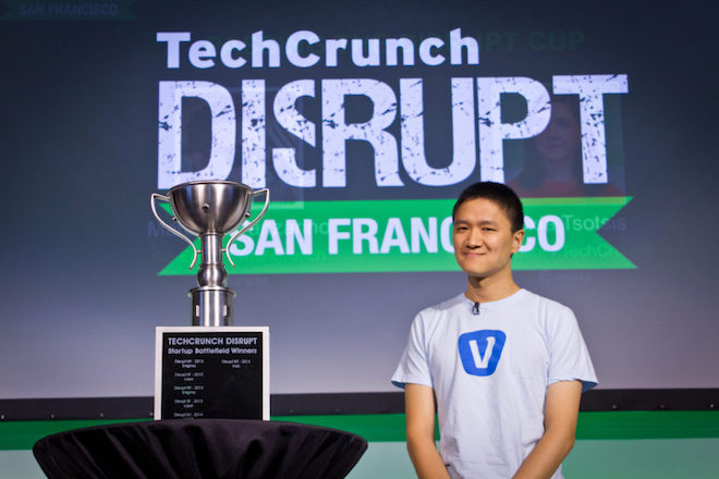 Above: Vurb CEO Bobby Lo stands on stage at TechCrunch Disrupt San Francisco to pass the trophy on to the next winner of the startup pitch contest. Image Credit: Ken Yeung