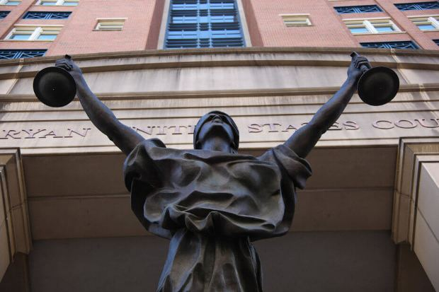 Above: A statue of blind justice outside the Albert V. Bryan United States Courthouse in Alexandria, Virginia Image Credit: Tim Evanson