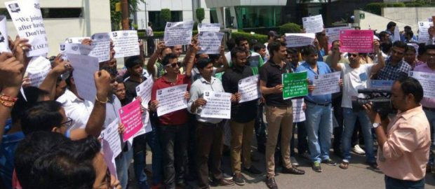 AskMe employees protesting outside their office for unpaid dues