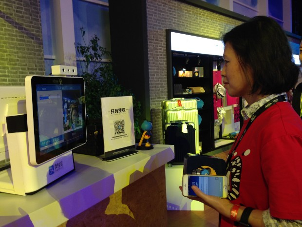 A user pays for a cup of coffee using Alipay's facial recognition.
