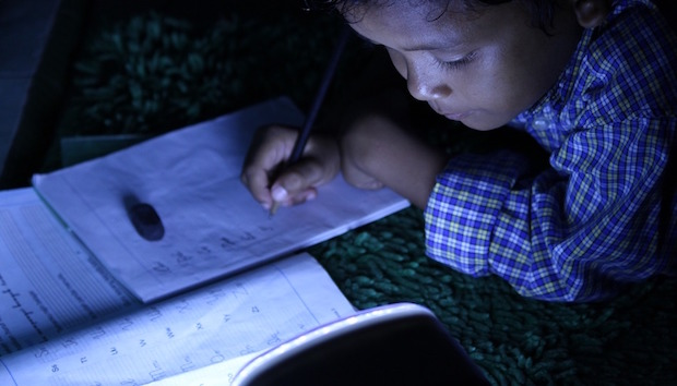 child-studying-using-lamp.jpg
